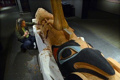 20131204dsTotemPoleMag07 Tommy Joseph works on the details of his totem pole.