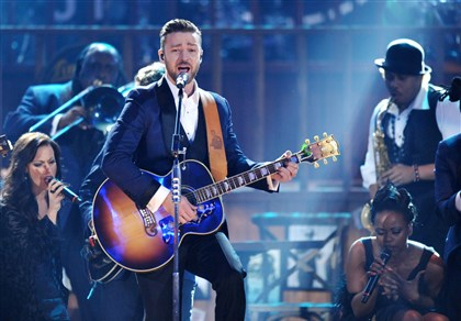 Shocal1208-8 Justin Timberlake performs on stage at the American Music Awards at the Nokia Theatre L.A. Live in Los Angeles.