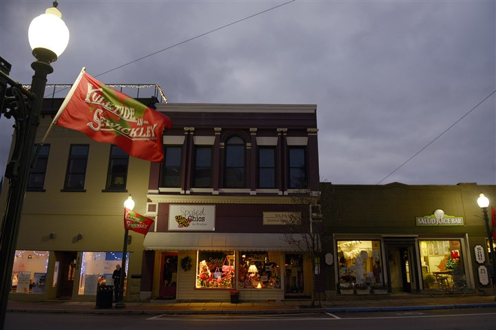 20131209jrDecorZones3-1 Holiday banners hang from the light poles along Beaver Road in Sewickley.