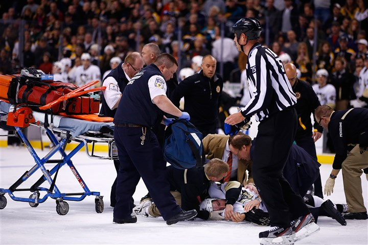 Orpik1210-1 The Penguins' Brooks Orpik is tended to by the medical staff on the ice after an altercation with the Bruins' Shawn Thornton during the game at TD Garden on Dec. 7.