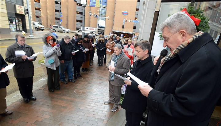 20131210radWaveOfPrayerLocal02-1 Bishop David Zubik presided over Pittsburgh's participation in the worldwide Wave of Prayer to end world hunger outside Catholic Charities' on Ninth St. in Downtown Pittsburgh during the noon hour.