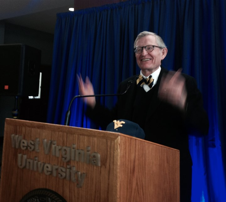 20131210 E Gordon Gee WVU 1 E. Gordon Gee acknowledges applause by supporters at a news conference Tuesday on the West Virginia University campus in Morgantown. Mr. Gee, 69, stepped up as an interim leader as the school's board seeks a permanent successor to Jim Clements.