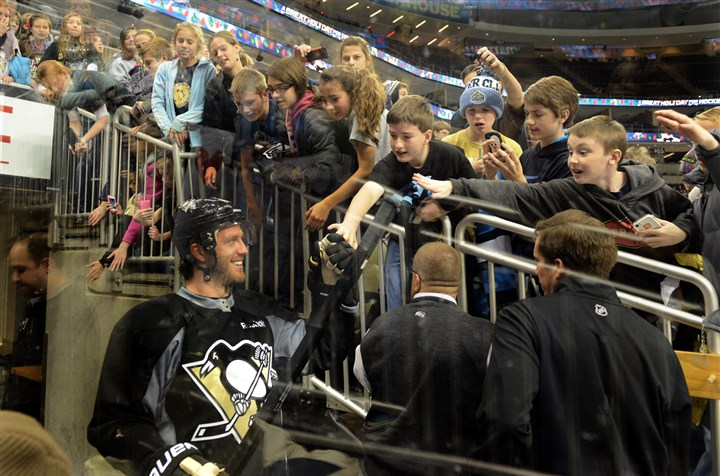 20131210 Penguins' Joe Vitale Joe Vitale acknowledges fans as he takes the ice for practice at the Consol Energy Arena on Dec. 10.