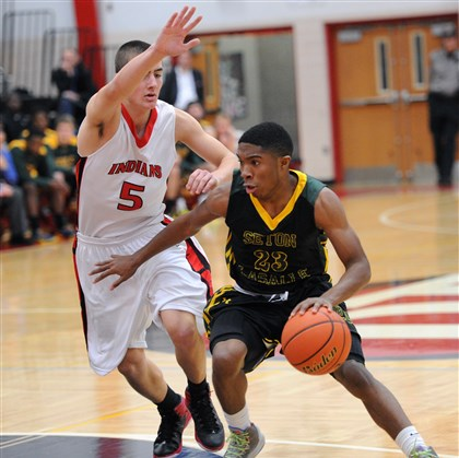 20131206JHSportsHOOPS10.jpg Seton-LaSalle's Dale Clancy drives past Peters Township's Nick Valentic during tipoff tournament game last Friday.