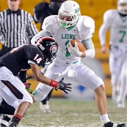 20131123mfheinzsports05.jpg South Fayette's Logan Sharp tries to evade a tackle by Aliquippa's Darrien Fields in the WPIAL Class AA championship game.