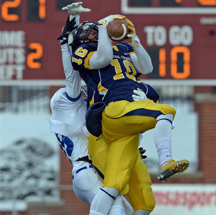 20131207mfcentralsports08.jpg Central Catholic's Cameron Sutherland intercepts a pass intended for Lower Dauphin's Jake Shellenberger in the PIAA semifinals.