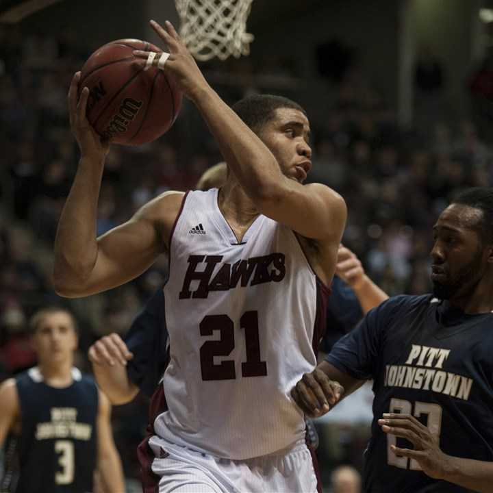 20131205hoSportsCottrell.jpg Gateway graduate Devon Cottrell averages nearly eight rebounds per game for IUP.