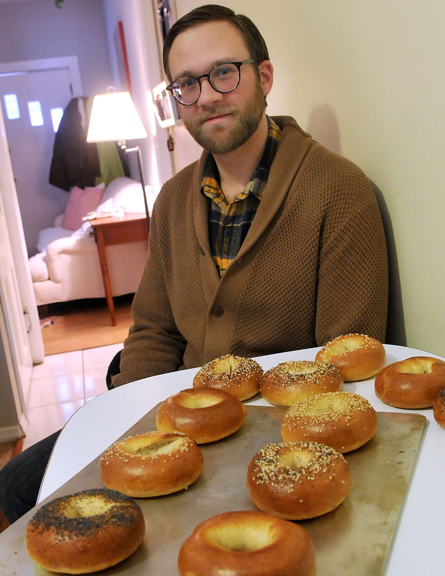 20131210lrbagelmag05-3 Evan Wood at his Lawrenceville home with a tray of bagels, which he baked for his Pittsburgh Bagel Club.