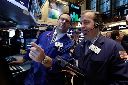 20131213apWallstreetBiz Specialist Anthony Matesic, left, and trader James Doherty on the floor of the New York Stock Exchange Monday.