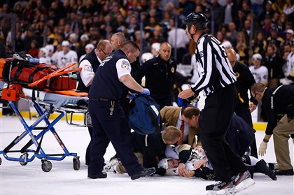 Orpik1210-1 Brooks Orpik of the Penguins is tended to by the medical staff on the ice in the first period after an altercation with Shawn Thornton of the Boston Bruins in the first period Saturday night at TD Garden in Boston.