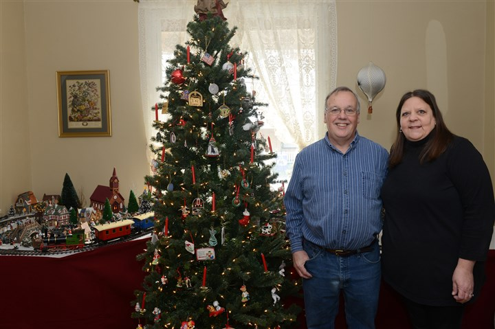 20131211rldTrainSOUTH06-5 Dave and Colette Frankowski stand with their Christmas train display at their home in Mt. Lebanon. Dave is a toy soldier collector and he built the train display to show off his collection.