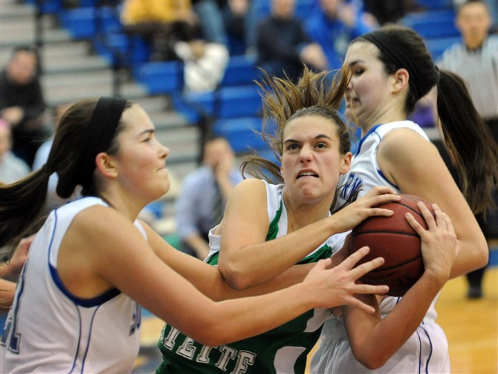 hshigh2 Autumn Mozick, center, fights for the ball with Halie Torris, left, and Elisa Derose, right, during a Section 5-AAA girls basketball game between South Park and South Fayette at South Park.