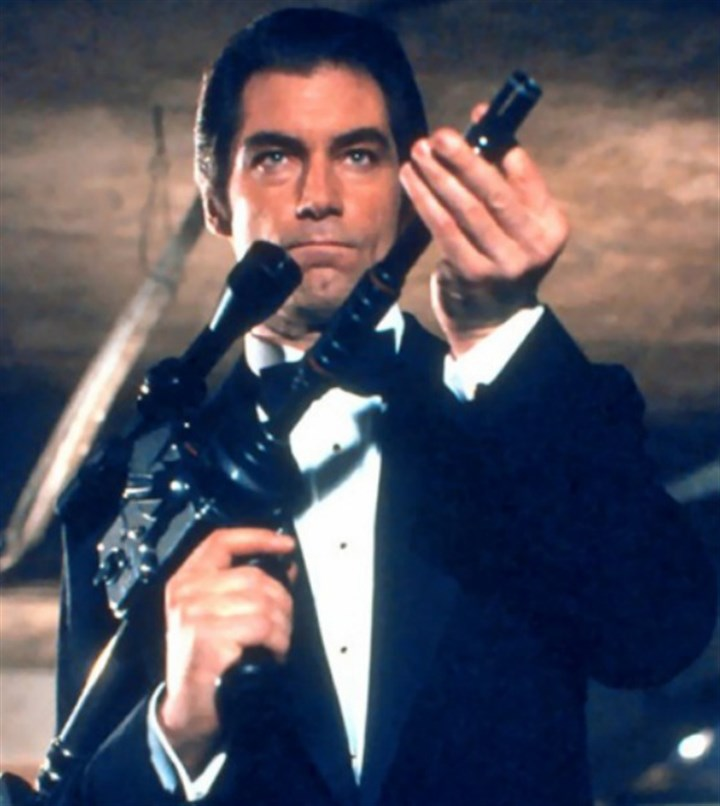 "Bondgun Timothy Dalton using the Hasselblad Camera Signature Gun in ""License to Kill."""