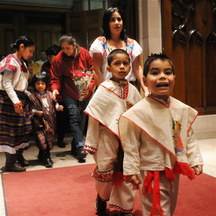 Guadalupe Parishioners from St. Regis in South Oakland have a festive procession Thursday into St. Paul Cathedral in Oakland for a feast and Spanish-language Roman Catholic Mass with Bishop David Zubik in honor of Our Lady of Guadalupe, patroness of the Americas. Several hundred people packed the church, paying tribute to their belief in an appearance of the Virgin Mary in Mexico in 1531 to an indigenous peasant, St. Juan Diego. The feast day is a central holiday for Mexicans and many other Latin Americans.