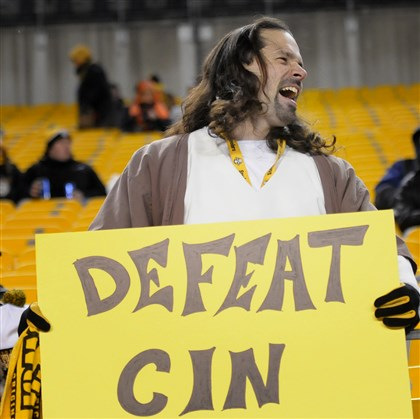 "Defeat ""Cin"" ""Jesus"" aka Matthew Schmitt, 41, of Connecticut preaches against ""Cin"" Sunday, December 15, 2013 before the Steelers game against the Cincinnati Bengals at Heinz Field. The Steelers did indeed conquer ""Cin"" on that night, 30-20."