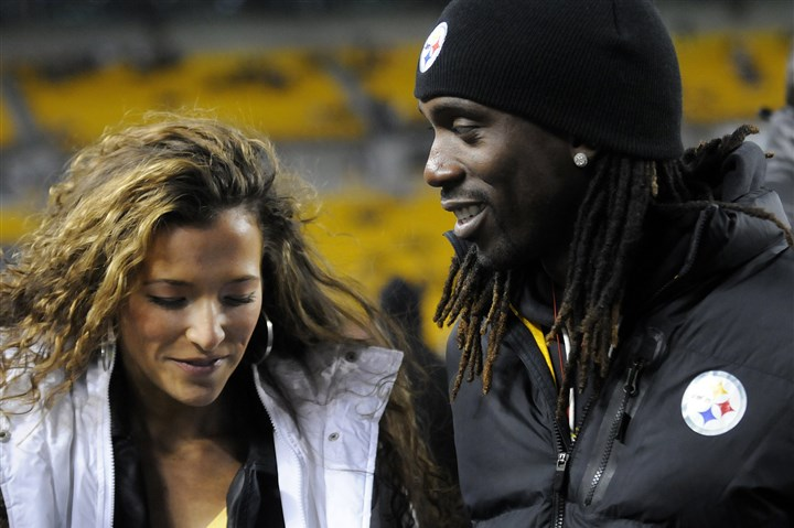 20131215jrSteelers3 Andrew McCutchen and his fiancee, Maria Hanslovan, take photos with fans on the Steelers sideline before the game against the Cincinnati Bengals tonight.
