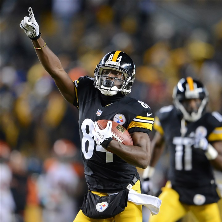 20131215pdSteelersSports01 Steelers wide receiver Antonio Brown celebrates on his way to the end zone, scoring his second touchdown of the game against the Bengals Sunday night at Heinz Field.