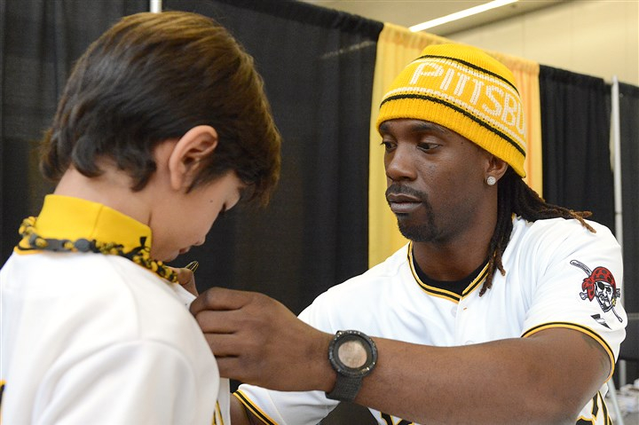 pirates1216 Andrew McCutchen, Pirates outfielder and National League MVP, autographs the Pirates jersey of fan Anthony Moreno, 9, of Bethel Park at PirateFest Sunday at David L. Lawrence Convention Center.