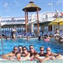 Guests on the Carnival Imagination pose in the pool.