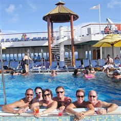 Guests on the Carnival Imagination Guests on the Carnival Imagination pose in the pool.