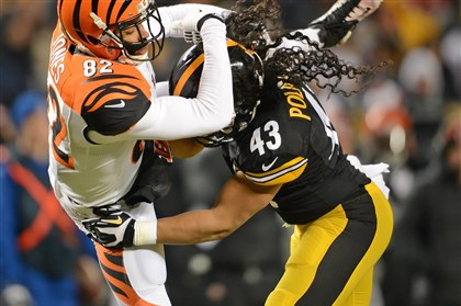 20131215pdSteelersSports06-1 Troy Polamalu defends Cincinnati's Marvin Jones at Heinz Field Dec. 15.
