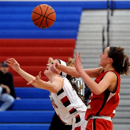 hshigh1217 Shaler's Lizzie Kline, left, is fouled by North Hills' Jamie Halloran in the second half Monday night at Shaler High School.