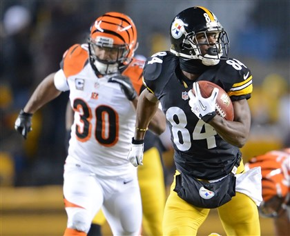 steel12173 Steelers wide receiver Antonio Brown takes a look behind him as he heads to the end zone, scoring his second touchdown of the game against the Bengals.