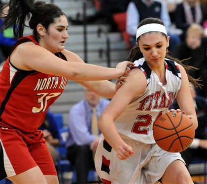hshigh3 North Hills Sierra Ungerman fouls Shaler's Andi Lydon in second half action at Shaler.