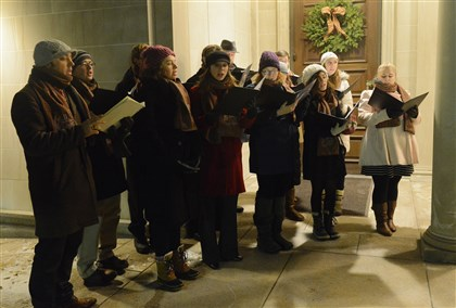 FEA The Boar's Head Wassail Consort performs outside the Frick Art Museum.