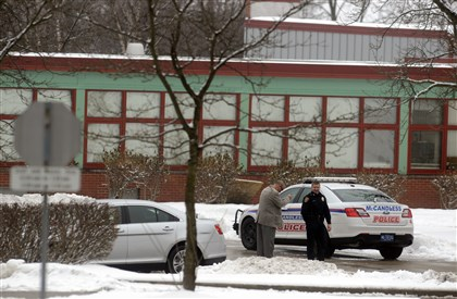 20131217dsLockdownLocal01 An Officer mans the entrance of the North Allegheny Intermediate High School on Tuesday morning. Three schools on the North Allegheny School District's Cumberland campus were on lockdown.