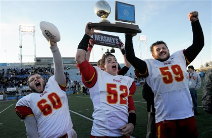 20131213ncatholic06.jpg Cardinal Wuerl North Catholic's Dylan Grieco, Joshua Churchin and Ryan Long celebrate their team's 15-14 victory against Old Forge in the PIAA Class A championship game.