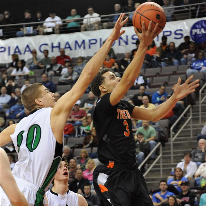 9ds00kjn.jpg Beaver Falls' Elijah Cottrill goes up for a basket as Holy Cross' Josh Kosin defends during last season's PIAA Class AA championship game at Giant Center in Hershey.