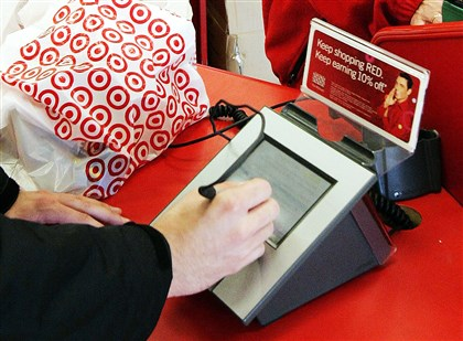 TargetCreditInfo A customer signs his credit card receipt at a Target store in Tallahassee, Fla. Target says that about 40 million credit and debit card accounts customers may have been affected by a data breach that occurred at its U.S. stores between Nov. 27, 2013, and Dec. 15, 2013.