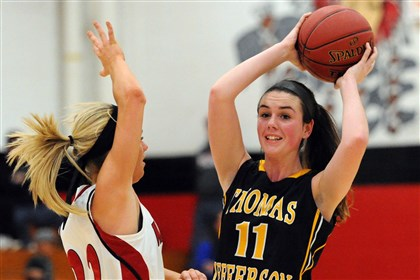 20131219JHSportsHoops05 Elizabeth Forward's Kylie Owoc, left, guards Thomas Jefferson's Courtney Zoglmann Thursday.