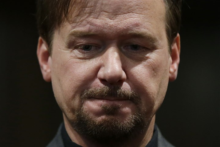 SCHAEFER3_nat-3 Former United Methodist pastor Frank Schaefer listens during a news conference, Thursday at First United Methodist Church of Germantown in Philadelphia. United Methodist church officials have defrocked Schaefer, who officiated his son's gay wedding in Massachusetts