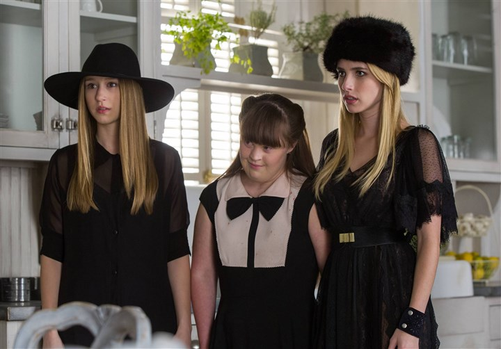 "coven From left, Taissa Farmiga as Zoe, Jamie Brewer as Nan, Emma Roberts as Madison in FX's ""American Horror Story."" -- CR."