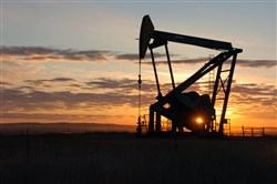 A Whiting Petroleum Co. pump jack pulls crude oil from the Bakken region of the Northern Plains near Bainville, Mont. on Nov. 6, 2013.
