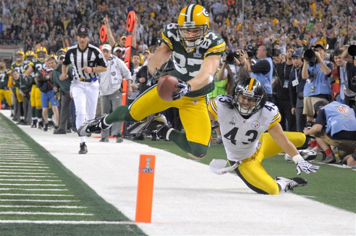 nelson1221 Packers receiver Jordy Nelson dives to the 3-yard line as he gets past Steelers safety Troy Polamalu in the third quarter of Super Bowl XLV in 2011.