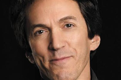 "albom1222bio Mitch Albom's novel is ""a slightly cheesy but somewhat interesting read."""