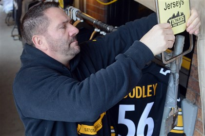 jerseysys1222new Jim Coen, owner of sports clothing store Yinzers, puts out the half-off sign on a rack of Steelers jerseys. The tent sale outside the Strip District store on Penn Avenue is moving out low selling shirts bearing the names of players who are injured or thought to be leaving.