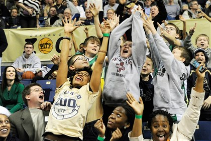 20131221rldPittMensBBball15-8 Fans react as a T-shirt is thrown into the stands during the Panthers' 73-56 defeat of the Cal Poly Mustangs at the Petersen Events Center in Oakland on Saturday afternoon.