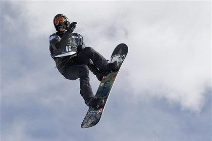 Snowboarder Shaun White Shaun White flies off a jump during the World Cup U.S. Grand Prix snowboarding qualifications Dec. 19, 2013, in Frisco, Colo.