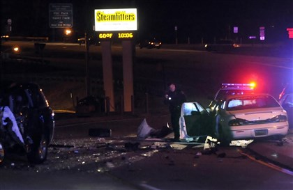20131222fatal2LOCAL Police investigate the scene of a wreck that left one man dead and another person in police custody for a suspected DUI Sunday night on Sawmill Run Boulevard near Woodruff St.