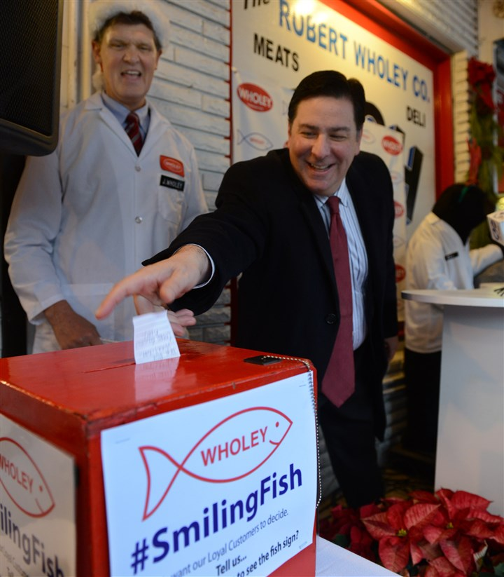 "20131223dsPedutoWholeysLocal01 Mayor-elect Bill Peduto cast his vote for the new home of the Wholey ""Light Up Fish Sign."" To the left is Wholey's CEO Jim Wholey."