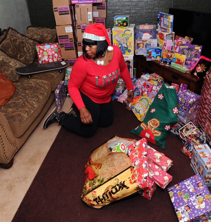 20131220JHLocalToys01 Brandi Boyd, who runs a toy drive for children who have lost a parent to violence, gathers her donated toys in her home in Beechview.
