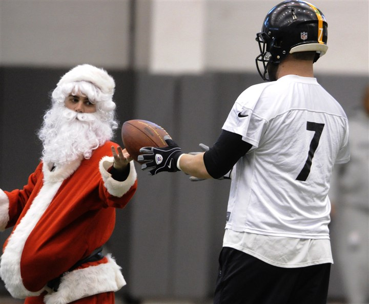 steele1225b Steelers equipment intern Brad Anderson delivers the football to quarterback Ben Roethlisberger during practice at the team's South Side facility.