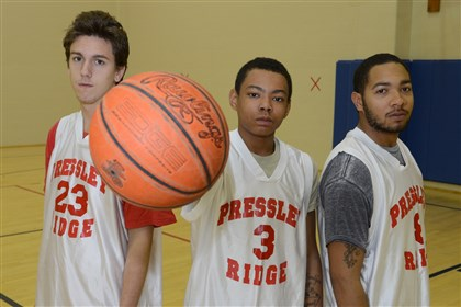 20131206lfPressleyRidgeSports07 Dante Yobst, 17, Kurtis Haddock, 15, and Sha'Ron Williams, 18, arrived at Pressley Ridge because of behavior issues and became teammates on the basketball team.