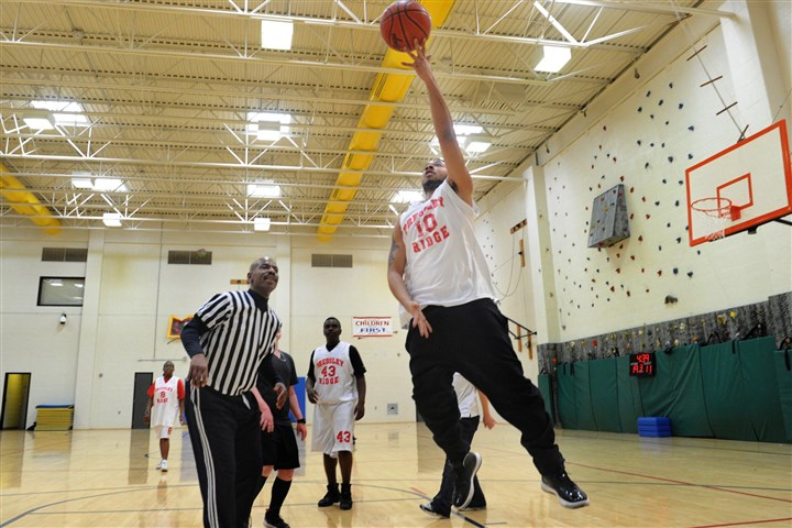 20130221lfPressleyRidgeSports02 Sha'Ron Williams, 18, goes up for a basket while playing a game at Pressley Ridge in February. At left, wearing referee stripes, is B.B. Flenory, a transition specialist at the school who also runs the basketball program he founded 10 years ago.