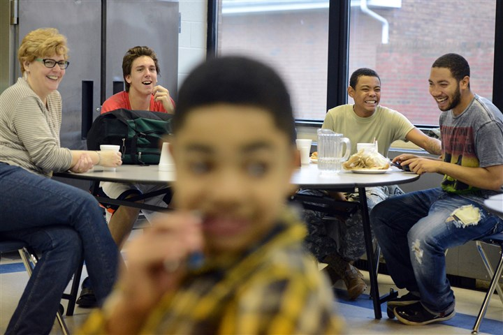 20131206lfPressleyRidgeSports11 Dante Yobst, Kurtis Haddock and Sha'Ron Williams share a laugh while having lunch with Patty Folmer, the ancillary coordinator at Pressley Ridge, in early December. Ms. Folmer supervises the school's sports teams. There is also flag football in the fall and soccer in the spring.