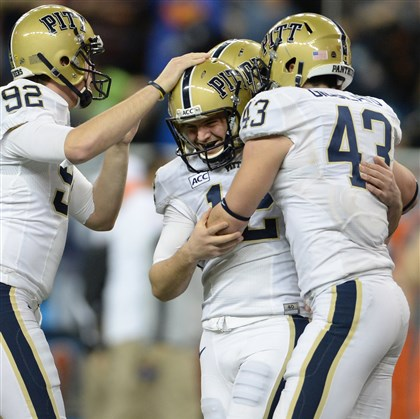 20131226mfpittsports12-11 Pitt's Chris Blewitt is congratulated after kicking the go-ahead field goal against Bowling Green in the fourth quarter in the Little Caesars Pizza Bowl on Dec. 26, 2013 at Ford Field in Detroit.